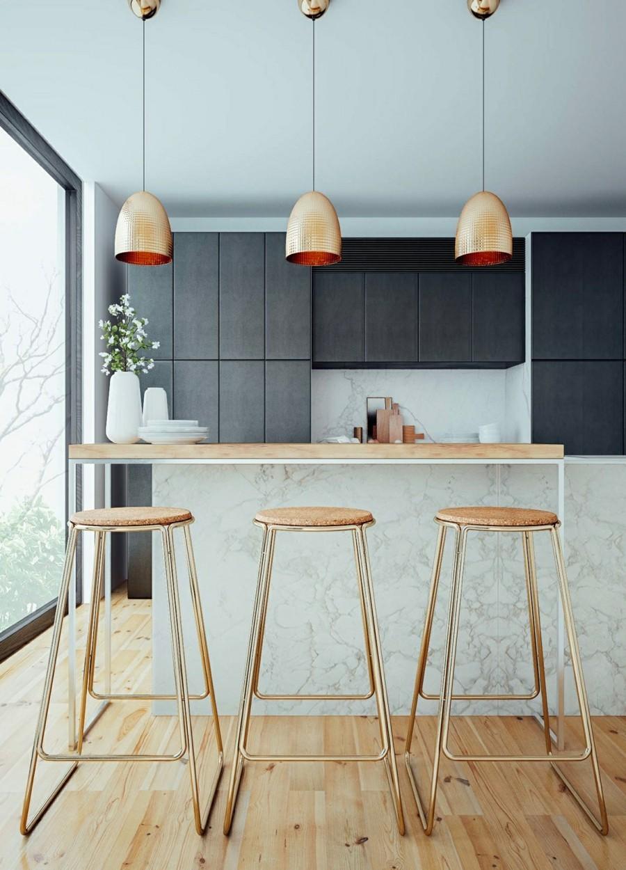kücheninsel mit marmor arbeitsfläche holz und hängeleuchten aus messing
