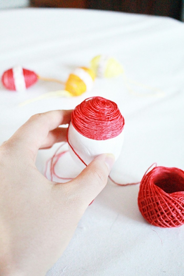 Decorate last-minute Easter eggs with yarn and decorative ribbon