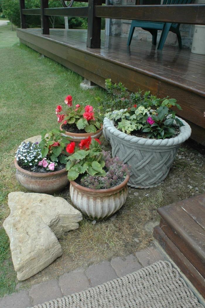 gartengestaltung ideen pflanzentöpfe und steine