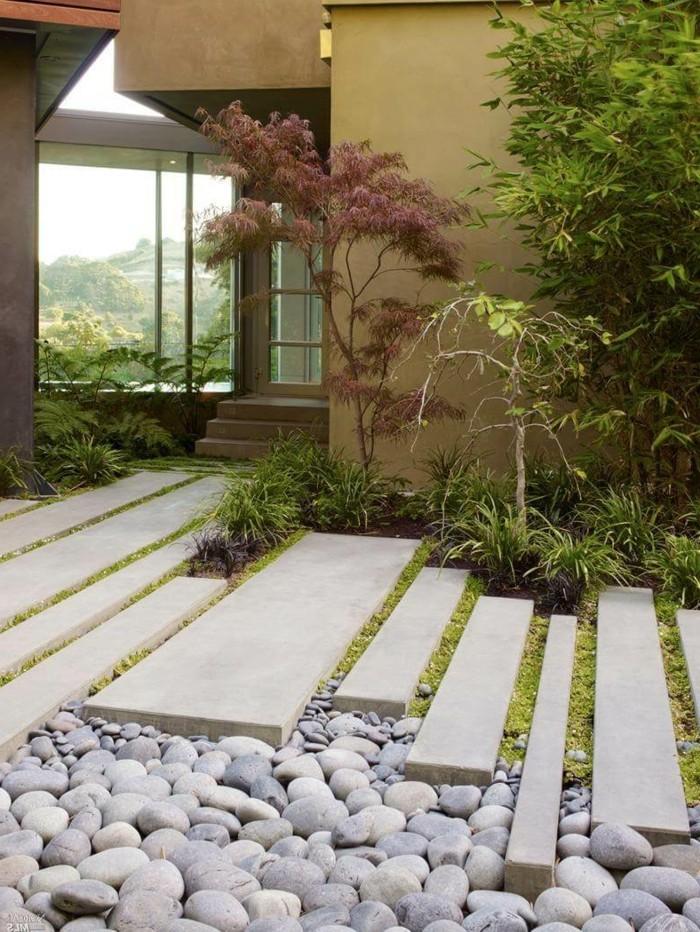 gartengestaltung ideen schöner gartenweg mit steinen und gras