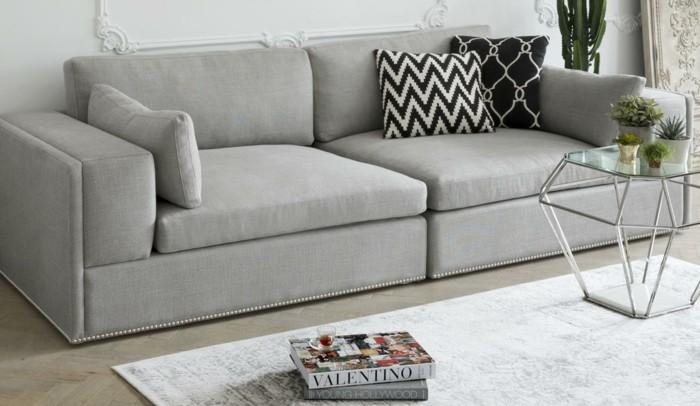 graue designer couch wohnzimmer einrichtungsideen dekokissen