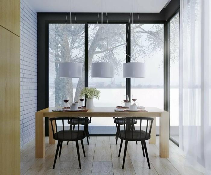 skandinavisch einrichten esszimmer mit schwarzen stühlen un ziegelwand