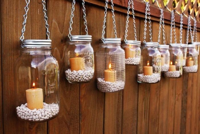 ausgefallene gartendeko selber machen zaun mit kerzen dekorieren