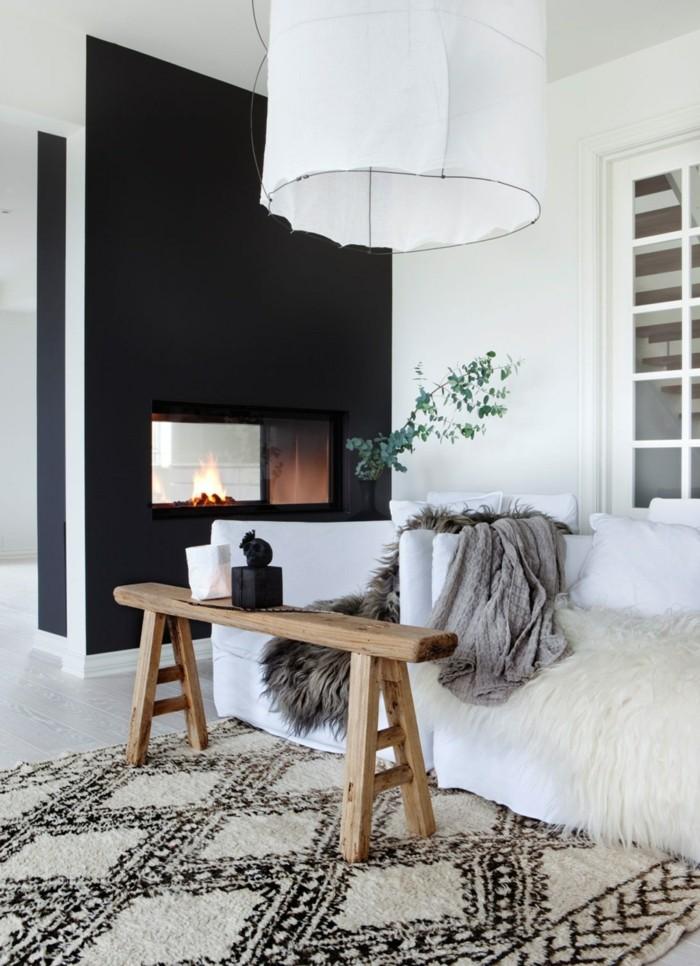 modernes wohnen schönes teppichmuster und ausgefallener couchtisch