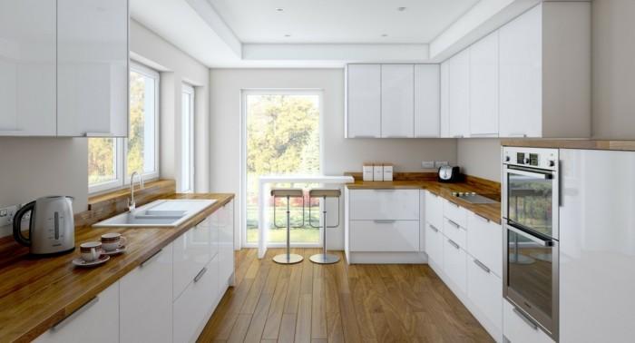 weiße küche mit holzboden und hölzernen arbeitsfläche