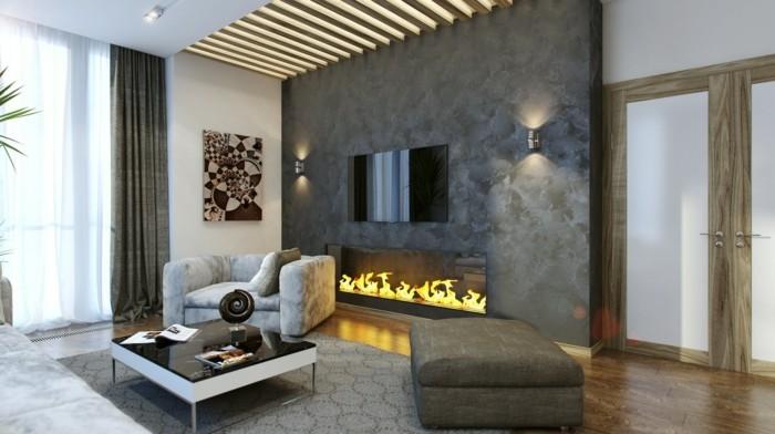 wohnideen wohnzimmer schöner wohnbereich mit ausgefallener beleuchtung und feuerstelle