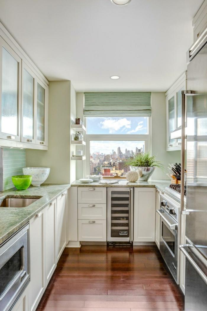moderne küche in u form mit hellgrünen wandfliesen