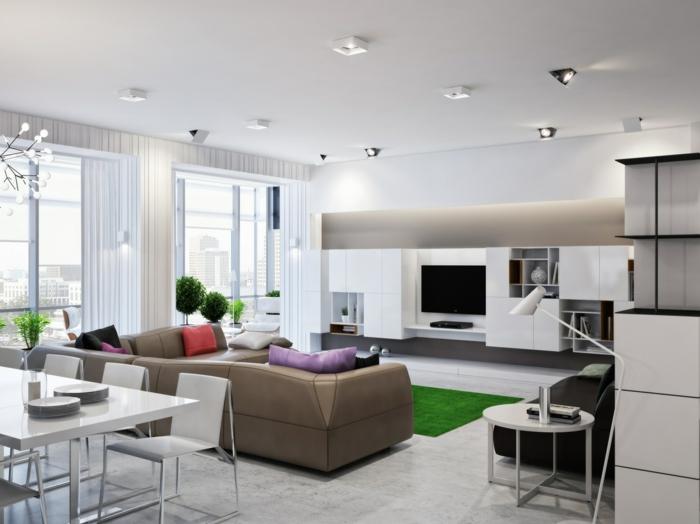 wohnküche schicker essbereich und trendiger wohnbereich mit grünem teppich