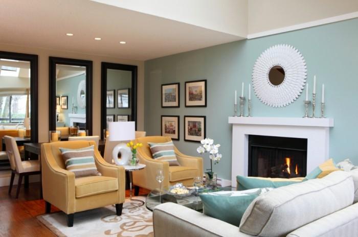wohnzimmer gestalten in hellgrün und gelb kamin und kerzen