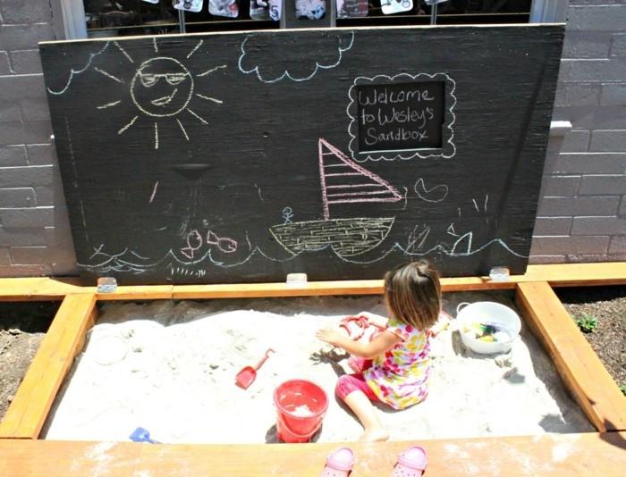 Sandkasten selber bauen mit malbrett