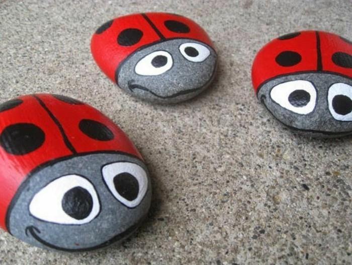basteln mit kindern kleine marienkäfer auf steinen malen