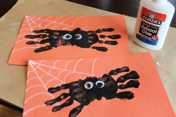 basteln mit kindern schwarzer krabbe aus handabdrücken
