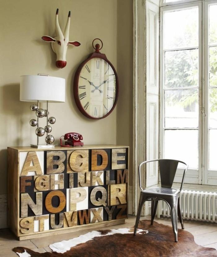 wohnung dekorieren originelle dekoideen mit buchstaben auf der vorderseite der kommode