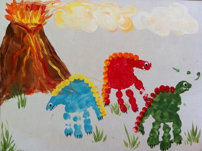 handabdruck bilder dinosauren und vulkan