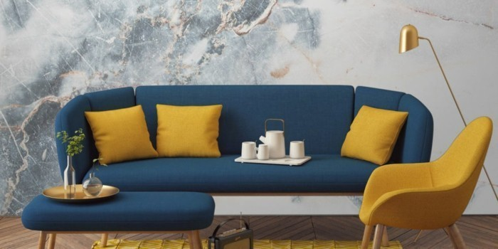 modernes sofa blautöne gelbe kissen sessel