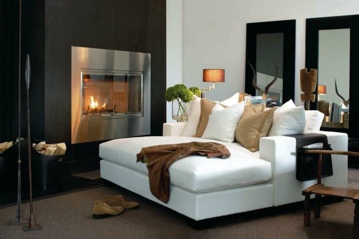 schlafcouch fomfortables tagesbett in weiß in einer gemütlichen atmosphäre