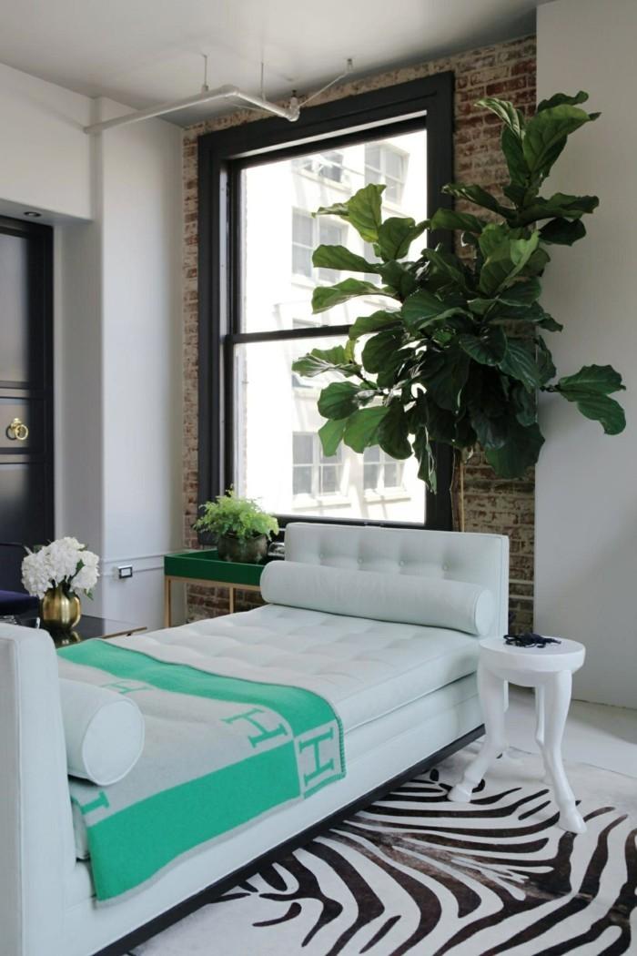 schlafcouch in weiß und zebra teppich kombinieren sich toll miteinander