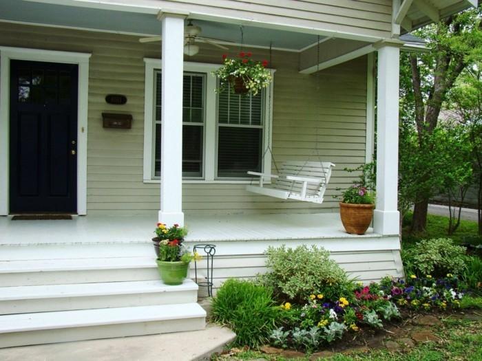 veranda gestalten mit schaukel und hängeampeln