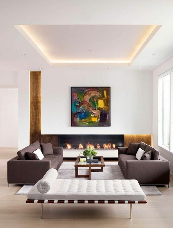 wohnideen wohnzimmer modernes weißes tagesbett und scicke braune wohnzimmersofas