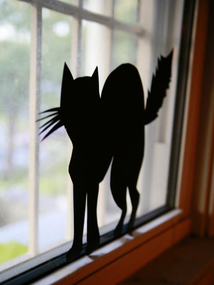 Fensterbilder basteln mit kindern regen scherenschnitt katze