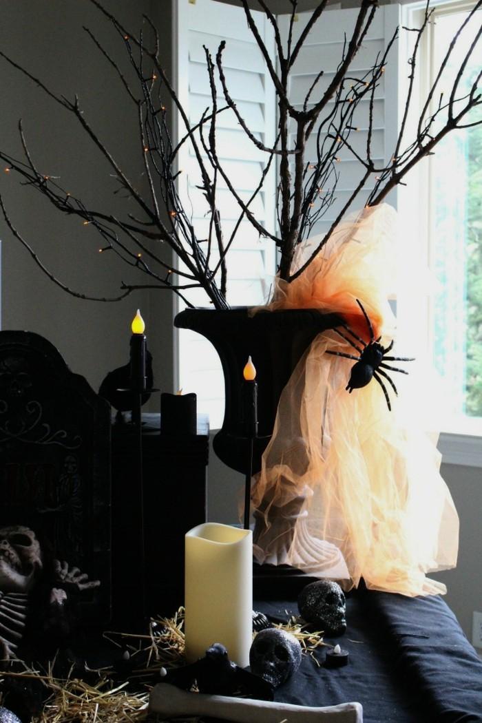 halloween deko stilvolle dekoration mit kerzen und zweigen