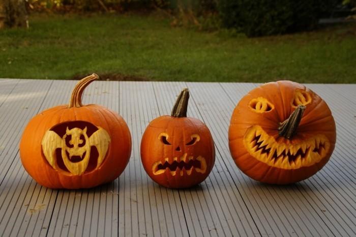 halloween kuerbis schnitzen unterschiedliche kuerbisgesichter
