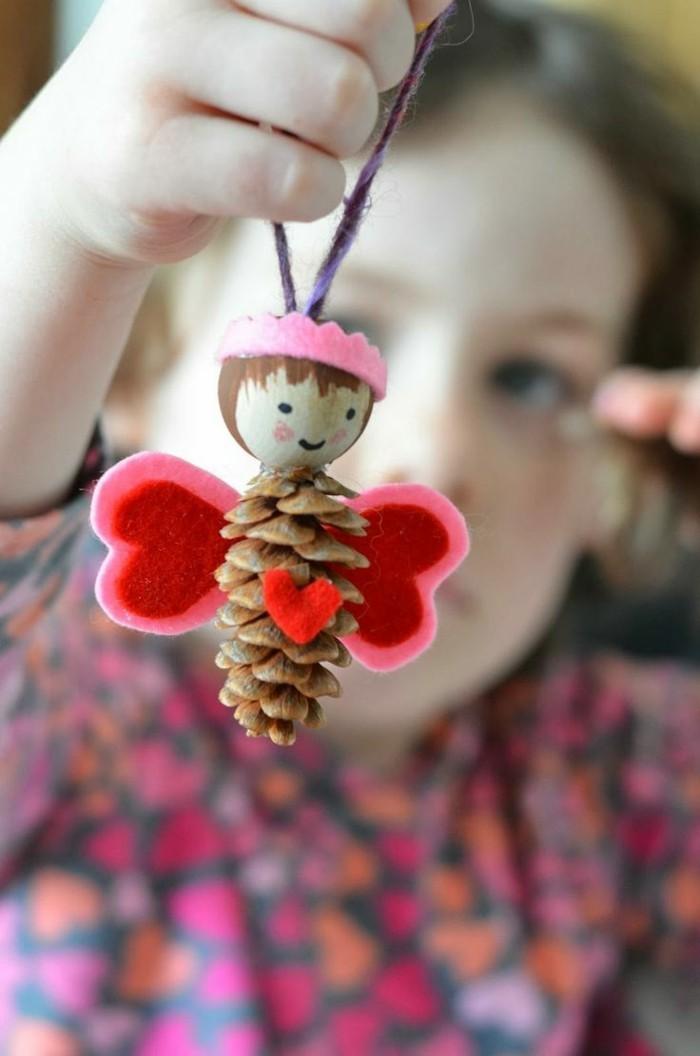 herbstdeko winterdeko basteln mit tannenzapfen kamin weihnachtsdeko aengel basteln
