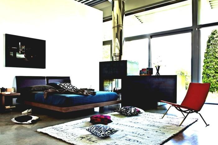 modernes schlafzimmer dunkle bettwäsche heller teppich roter sessel