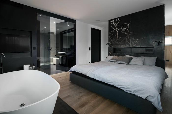 schlafzimmer einrichten freistehnde badewanne schwarze akzentwand