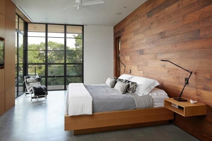 wandverkleidung holz schlafzimmer grauer bodenbelag hellgraue bettwäsche