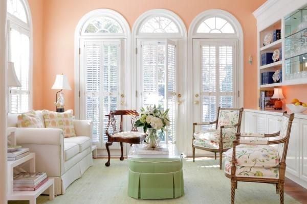 wandfarbe apricot grüner couchtisch schicke wohnzimmereinrichtung