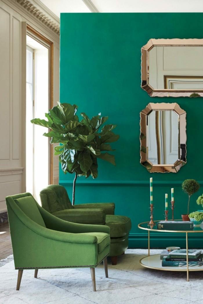 wandfarbe petrol wohnzimmer grüne sessel heller teppich