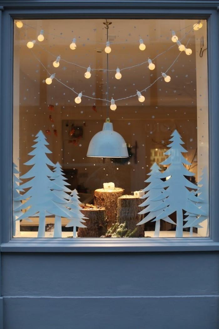 weihnachtsdeko fenster tannenbäume baumstämme kerzen