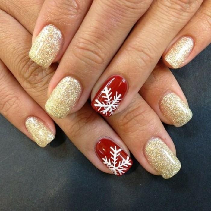 weihnachtsnägel roter nagellack goldene akzente schneeflöckchen