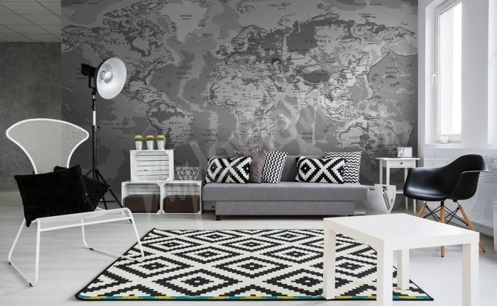 weltkarte wand wandmalerei schöne muster textilien weiße möbelstücke