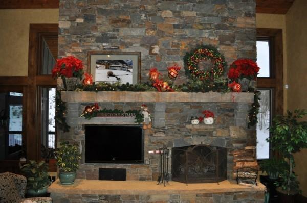 grüne girlande weihnachtskamin dekorieren deko äpfel