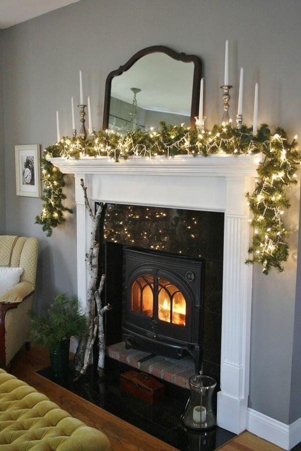 grüne zweige weihnachtskamin dekorieren deko tolle leuchten