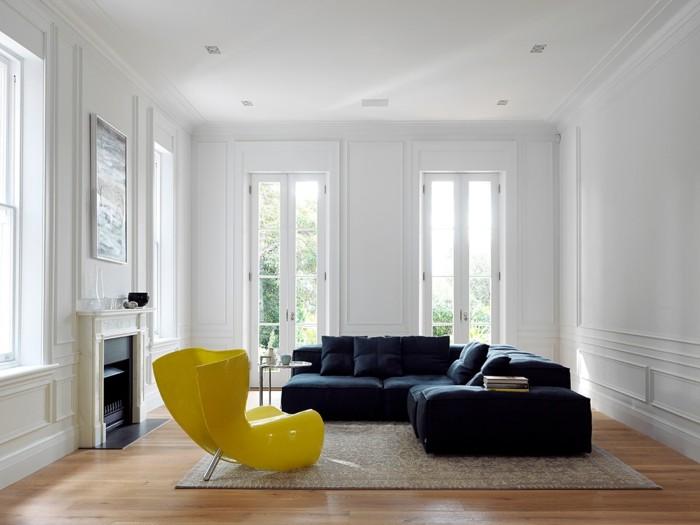 minimalistisch wohnen elegantes ecksofa gelber sessel