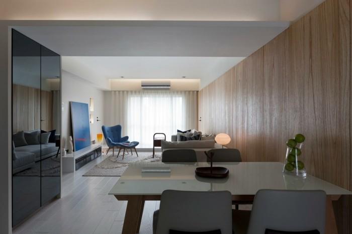 minimalistisch wohnen naurfarben blauer sessel