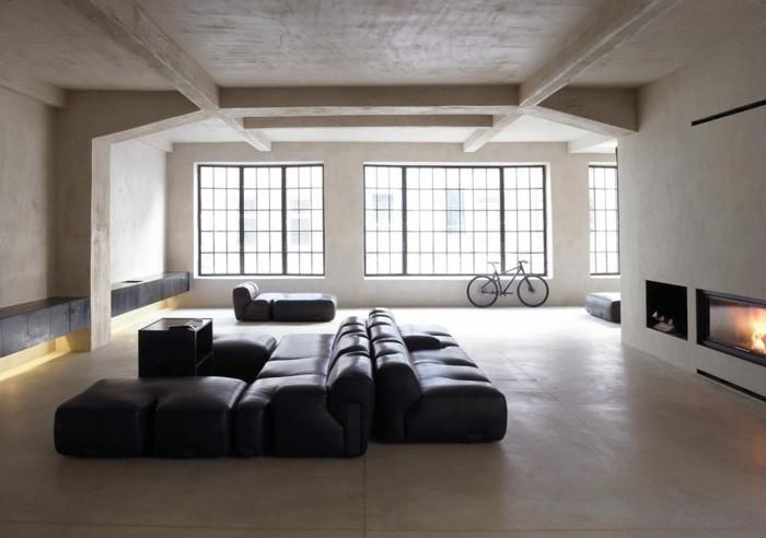 minimalistisch wohnen stilvolle wohnzimmereinrichtung ledersofa feuerstelle