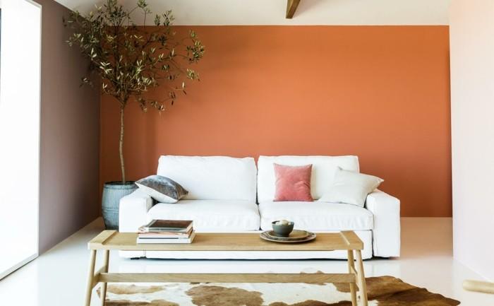 minimalistisch wohnen wohnzimmer orange akzentwamd gemütlich