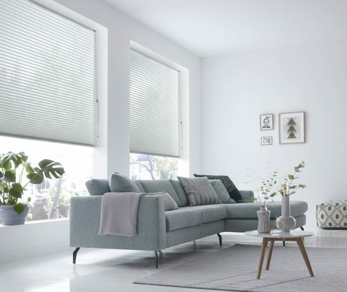 plissees helles wohnzimmerdesign weißer teppich pflanzen hellgraues sofa
