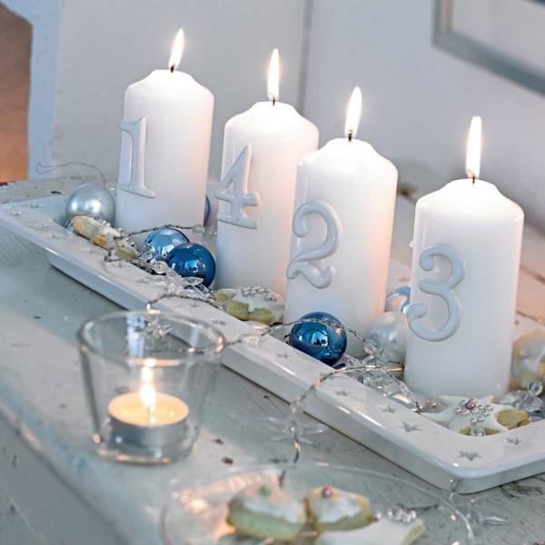 weisse stumpfkerzen servierteller christbaumschmuck zimtsterne adventskranz selber machen