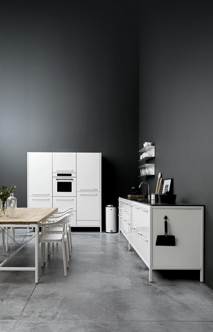 betonboden hellgrau schwarze wände weiße möbelstücke