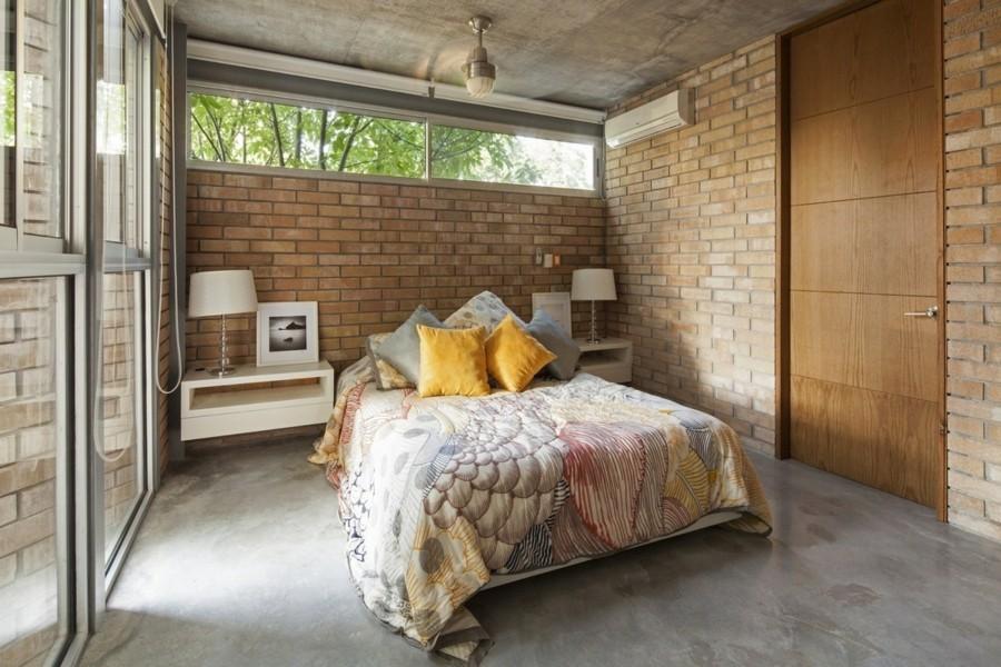 betonboden kleines schlafzimmer ziegelwand