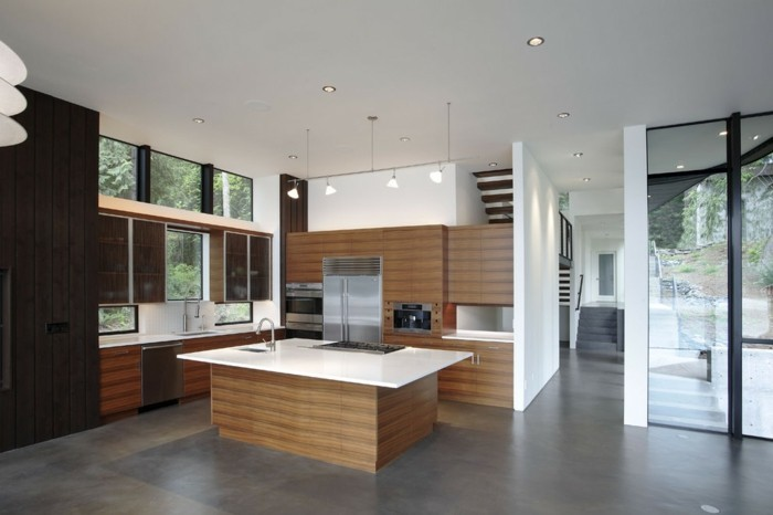 betonboden moderne küche schöne holztexturen weiße oberflächen