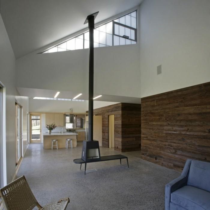 betonboden offener wohnplan hölzerne wandgestaltung moderne möbel