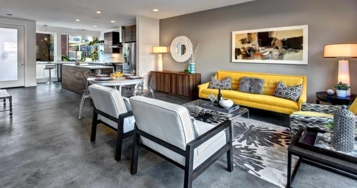 betonboden schöner bodenbelag wohnzimmer gelbes sofa