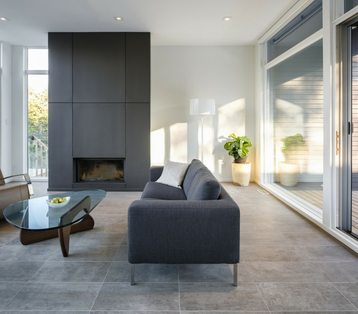betonboden wohnzimmer einrichten ideen moderner tisch graues sofa