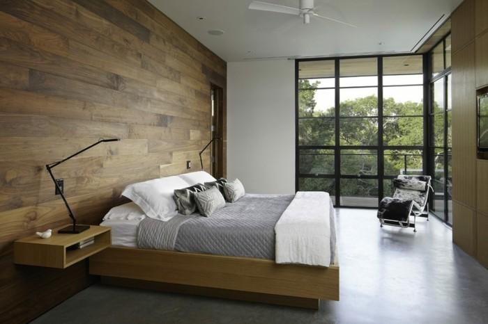 bett ohne kopfteil moderner schlafbereich hölzerne wandverkleidung